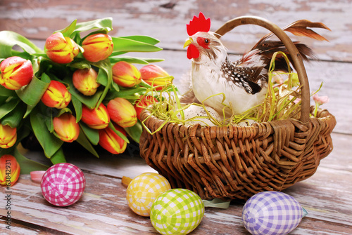 wicker basket with rooster and eggs for easter