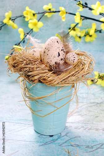 easter decoration with eggs in a hay nest