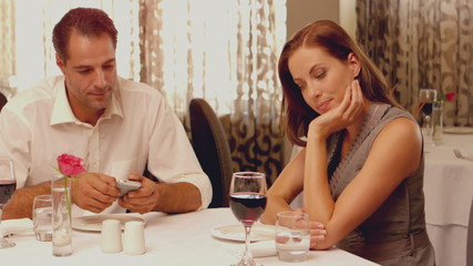 Woman being ignored on a date