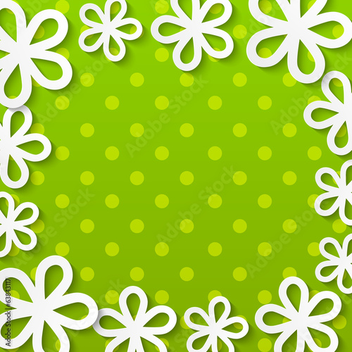 Paper floral frame on green