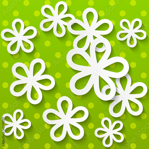 Paper flowers on green background