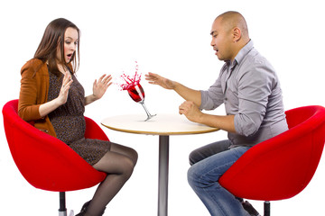 clumsy man spilling a drink on his date
