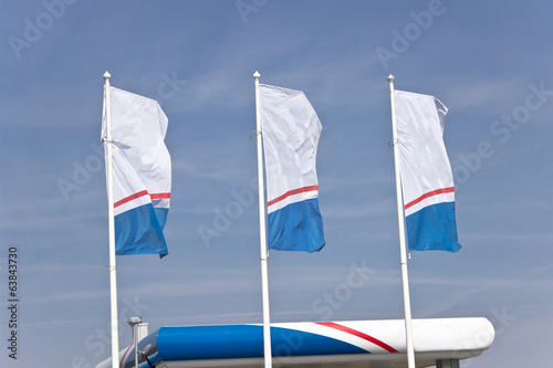 Three empty  banner flags over blue sky