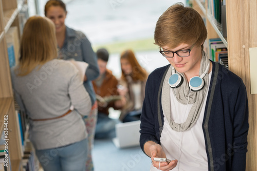 Student with headphones in college library