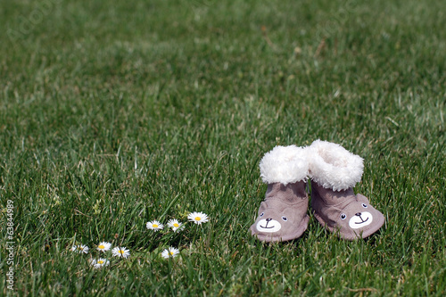 Little shoes on grass