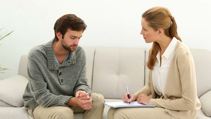 Young man talking to his therapist