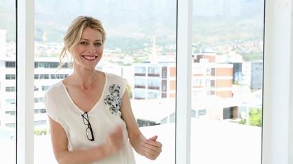 Happy businesswoman dancing