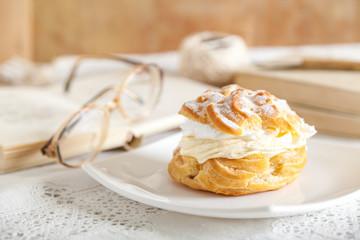 Cream donut on grandmothers table