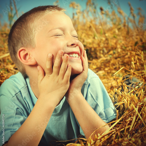 Happy Kid in the Wheat