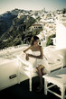 Young woman in Santorini,Thira, photo in vintage style