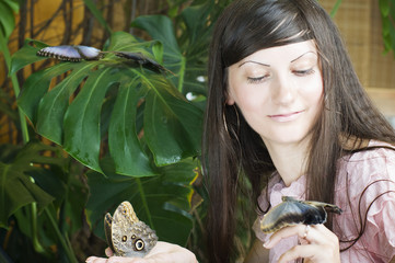 Portrait of beautiful girl with butterfly