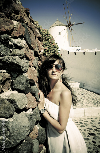 Young woman on holidays, Santorini, photo in vintage style