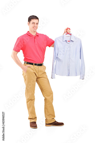 Man holding a shirt on a hanger