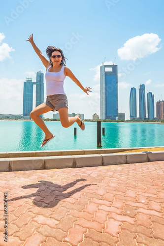 Happy woman on holidays in Abu Dhabi, UAE