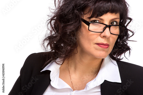 Portrait of mature woman smiling, wearing glasses, looking at ca