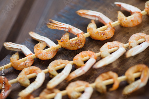 Close-up of grilled shrimps kebabs, shallow depth of field