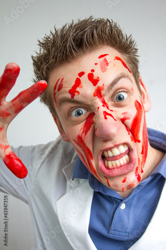 crazy funny guy covered in blood