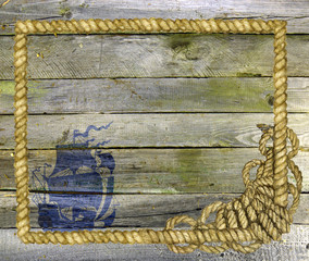 Wooden planks with shipe and rope