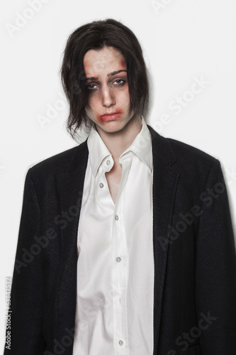 Beaten up girl wearing shirt and suit