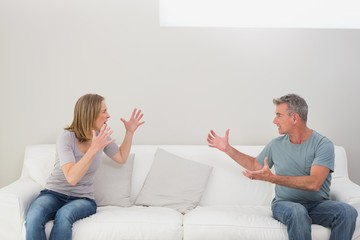 Unhappy couple having an argument in living room