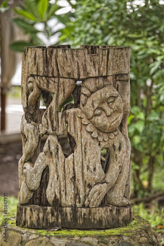 wooden tiki on tropical paradise beach
