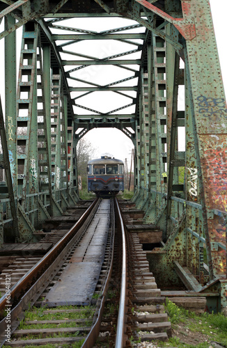 old train on iron bridge