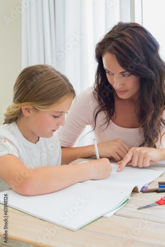Mother assisting daughter in homework