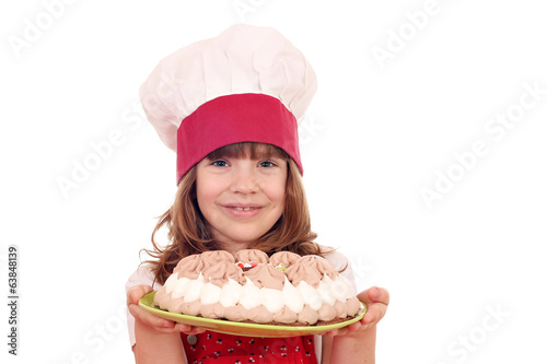 beautiful little girl cook with cake