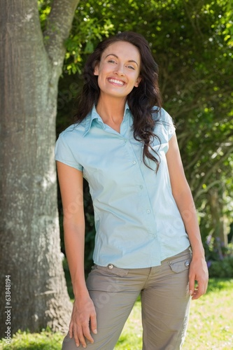 Happy woman standing in park
