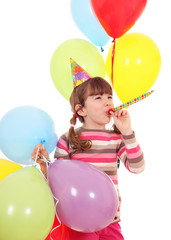 happy little girl with trumpet hat and balloons birthday party