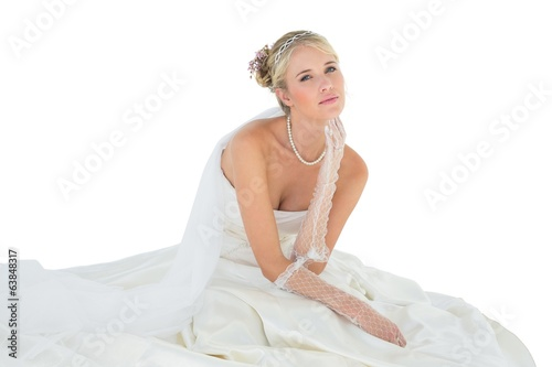 Sensuous woman in wedding dress over white background