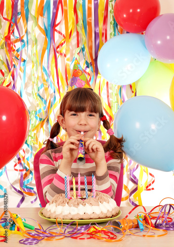 happy little girl with trumpet and cake birthday party
