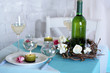 Beautiful holiday Easter table setting in blue tones,
