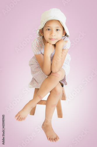 injury cute girl sitting on wooden seat