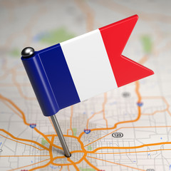 French Small Flag on a Map Background.