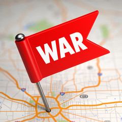 War - Small Flag on a Map Background.
