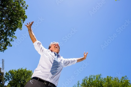 Excited businessman screaming