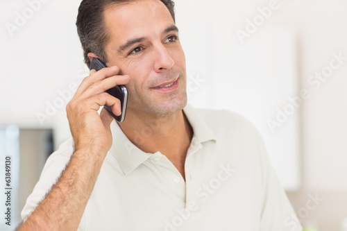 Closeup of a man using mobile phone at home