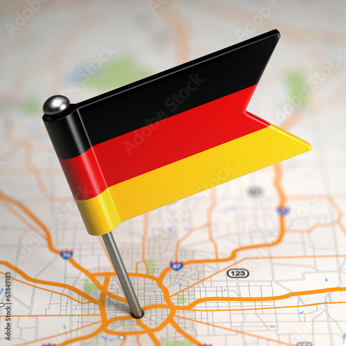 Germany Small Flag on a Map Background.