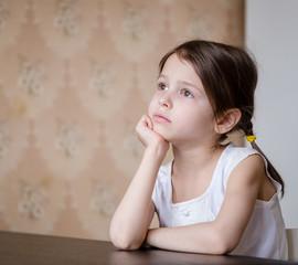 Thoughtful adorable preschooler girl