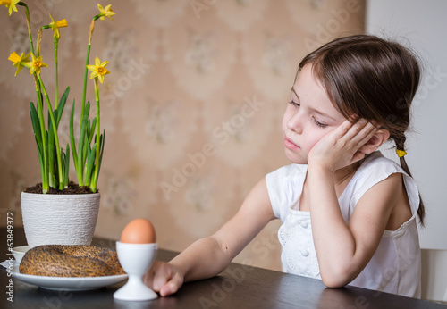 Thoughtful preschooler girl refusing to eat