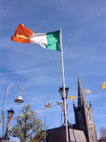 irish flag and old church
