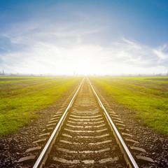 railway leawing far to a sunrise