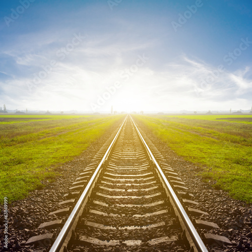 railway leawing far to a sunrise
