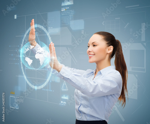 smiling businesswoman working with virtual screen