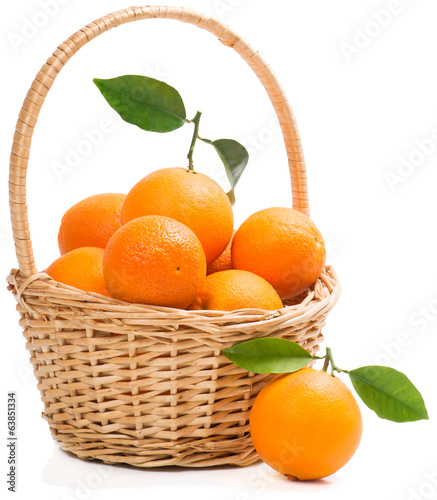 Basket full of ripe sweet oranges.