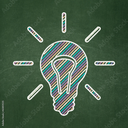 Business concept: Light Bulb on chalkboard background