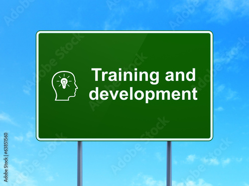 Education concept: Training and Development and Head With