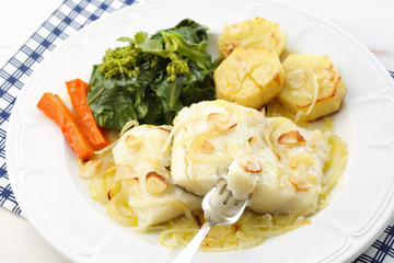 roasted fresh cod fillet with cabbage and potatoes-traditional p