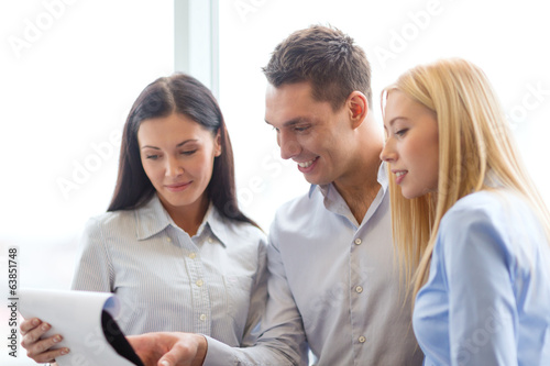 business team looking at clipboard